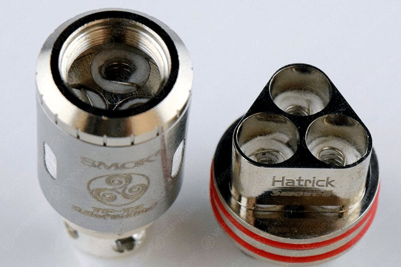 SMOK TFV-4 TF-T3 next to the Smowell Hatrick Triple Coil