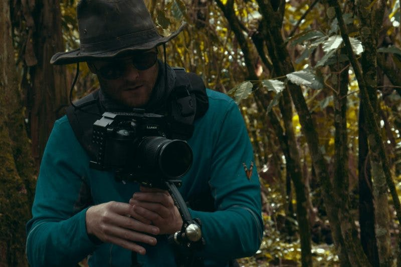 Chief Cinematographer - Jimi Jake Shaw searching rainforest for wild tobacco